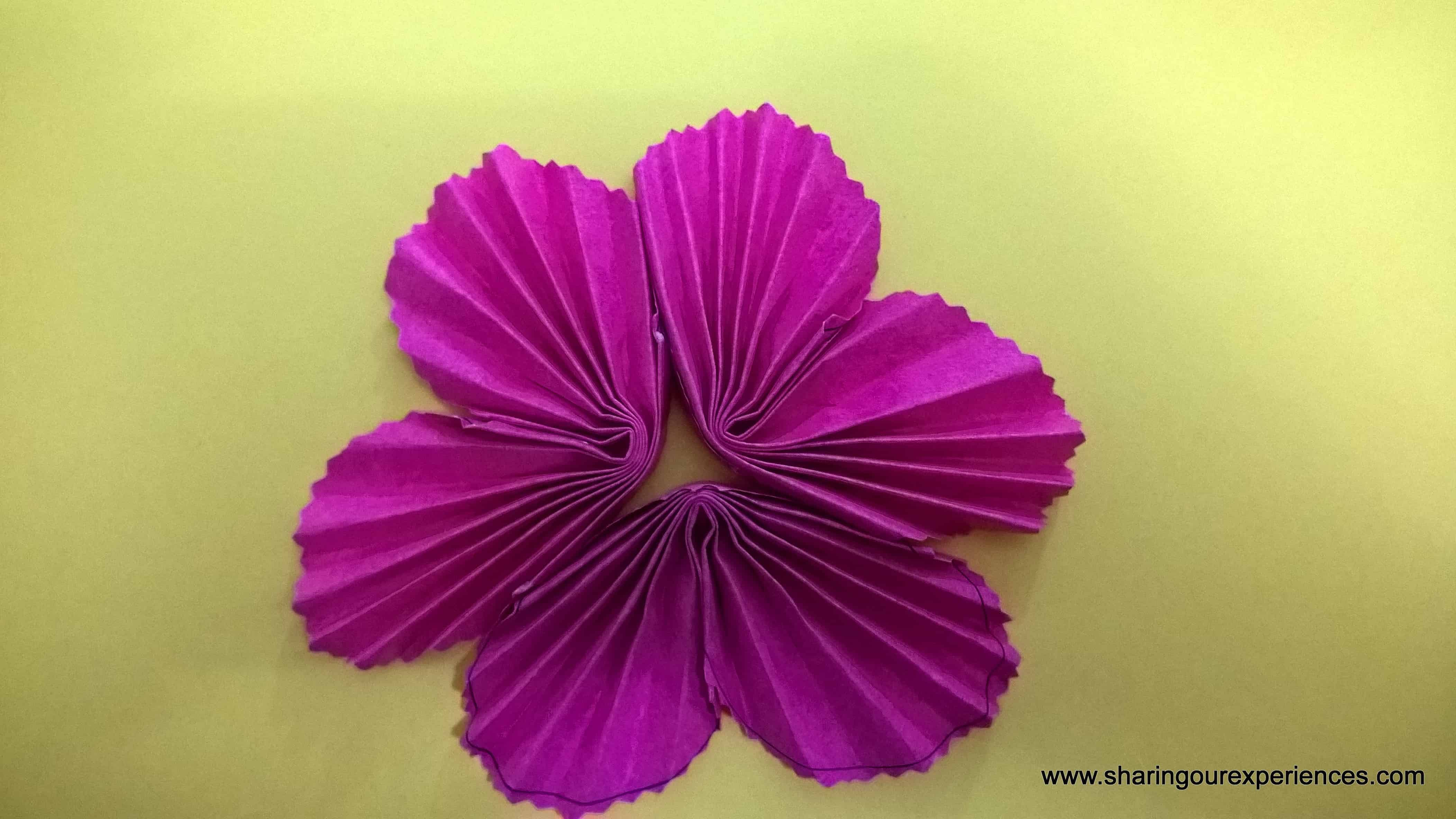 A Step By Step Tutorial On How To Make Simple Paper Flowers