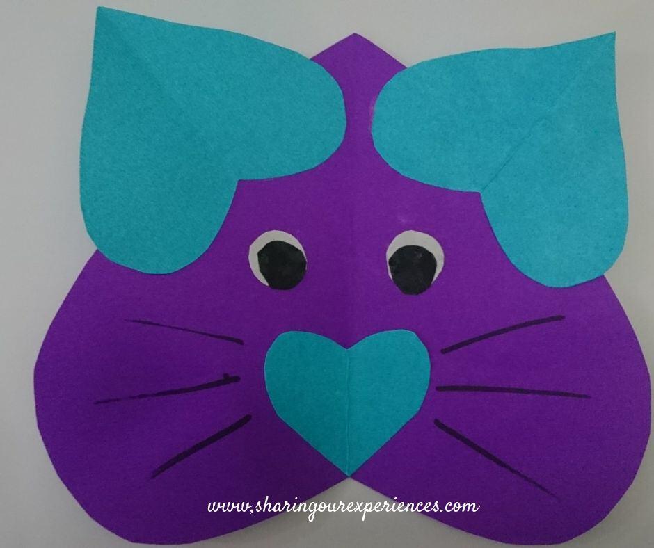 cat using hearts