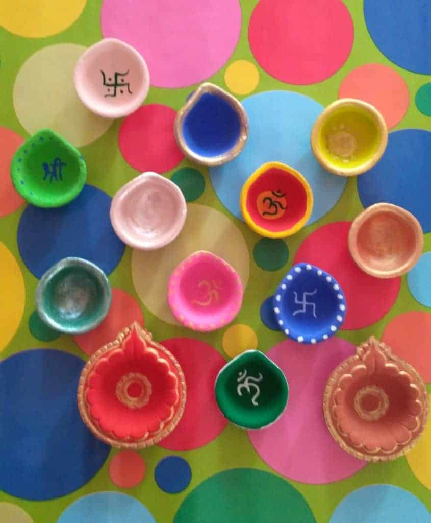 diya painting with poster colours or acrylic colours.  How to paint your own Diyas this Diwali. diwali gift ideas for kids
