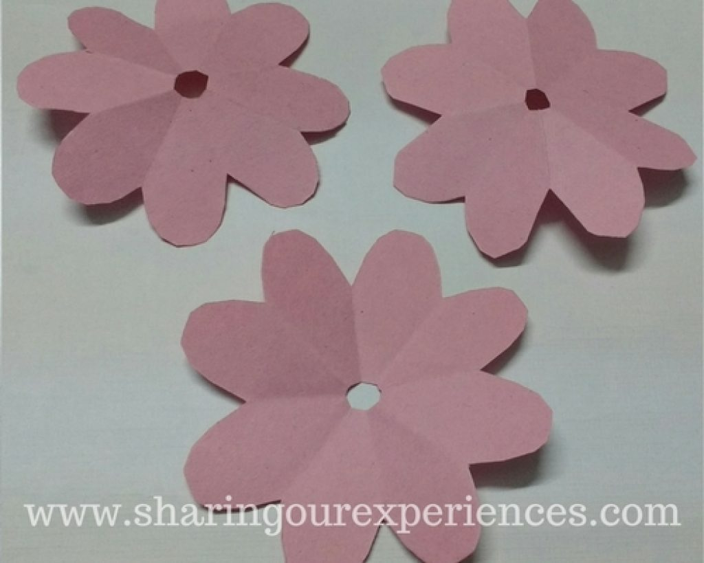 Diy crepe paper rose flowers sharing our experiences you will have 3 flowers with 8 petals each to make the center of flower cut the sharp edge of triangle to make a tiny hole mightylinksfo