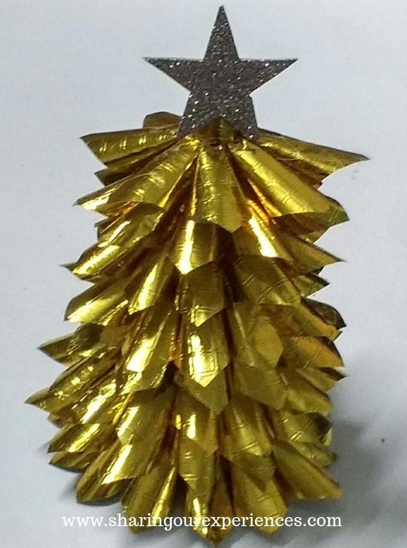 christmas tree with gold papercones