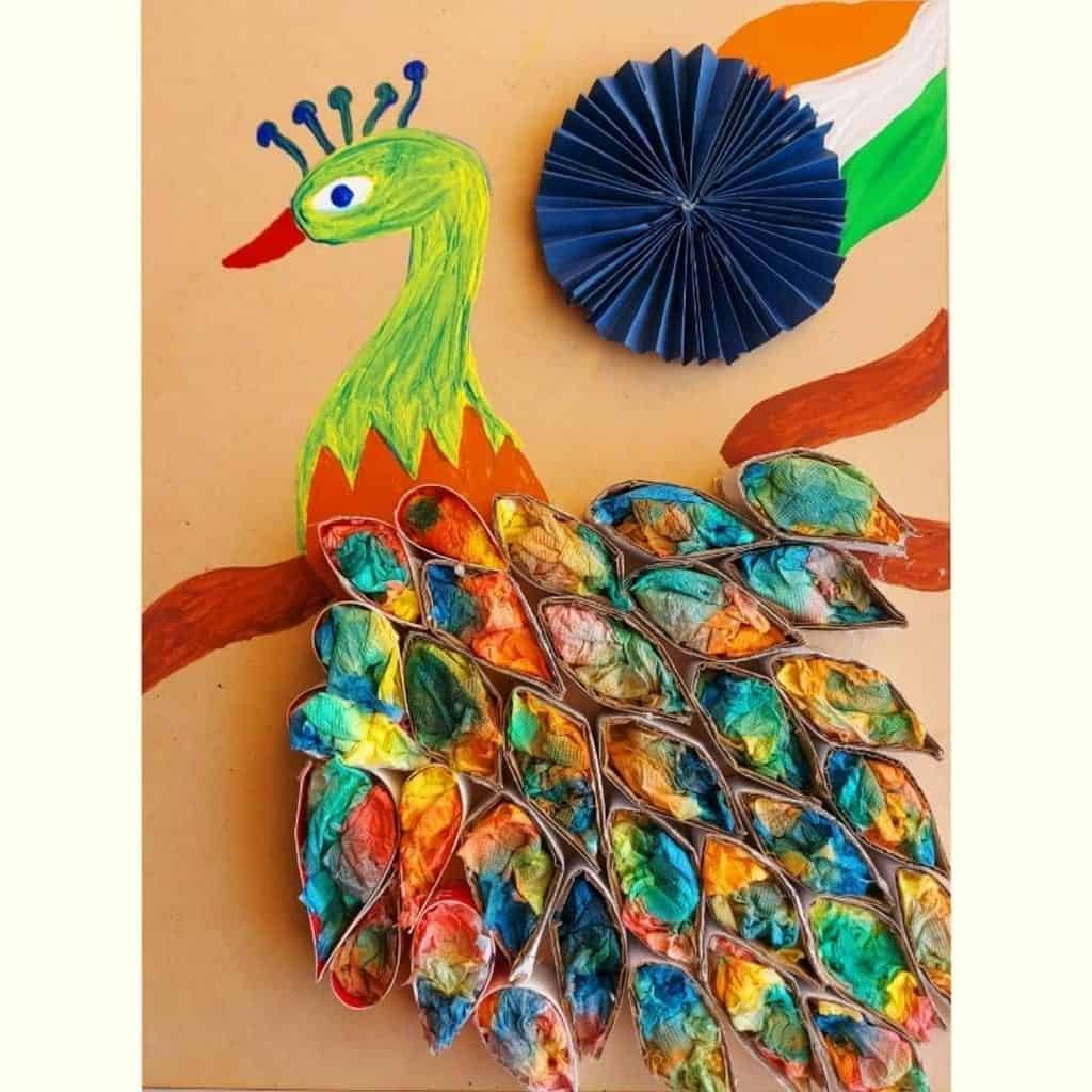 Decorating peacock feathers with painting on tissue paper