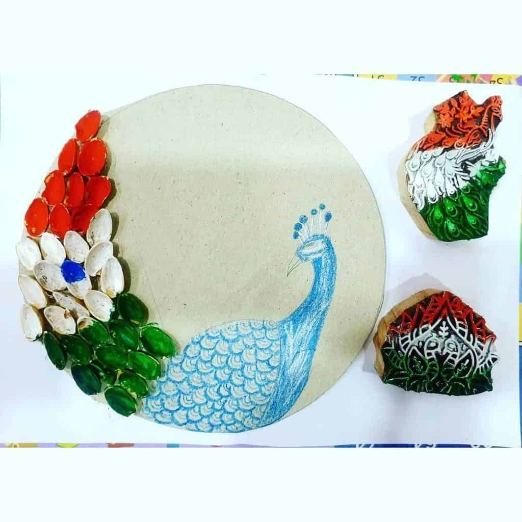 Pista Shells Peacock feathers best out of waste artwork for Preschoolers
