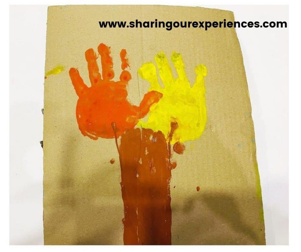 Hand impression for color Holi activity for toddlers
