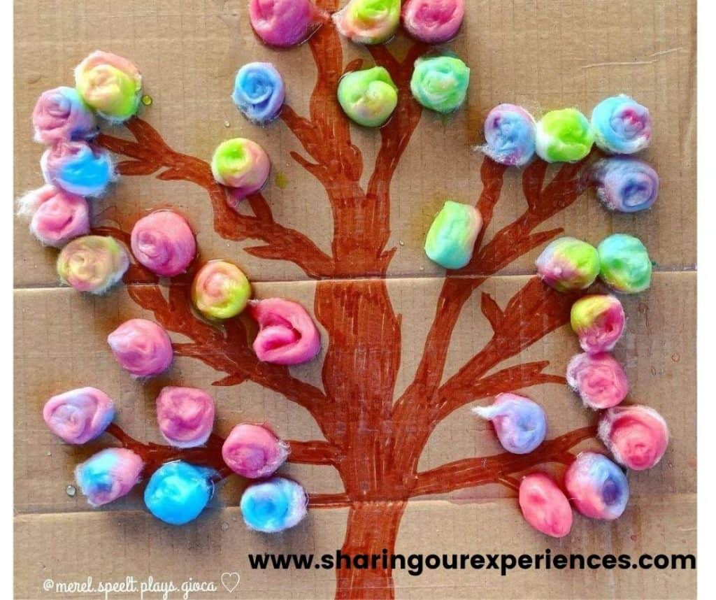 colorful tree made using cotton balls for toddlers. spring craft for preschoolers and kindergartens for theme based activity for school projects and book reading